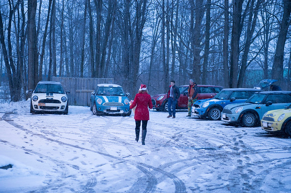 Joed Viera/Staff Photographer Lockport, NY- Members of the Mini Cooper Club pack their vehicles with presents destined to the Youth Mentoring Service of Niagara County.
