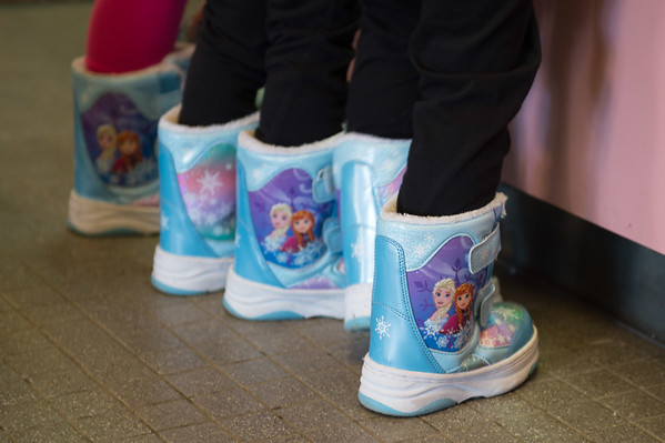 Joed Viera/ Staff Photographer- Lockport, NY-A trio of matching pairs of Frozen boots waiting for concessions at the Palace Theatre before the premiere of Moana.