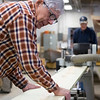 Joed Viera/Staff Photographer Buffalo, NY- Pete Stapell and Clint Starke cut boards of wood for the boat that will be used inside the flight of five at the Buffalo Maritime Center.