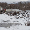 Joed Viera/Staff Photgrapher-Lockport, NY-A light coat of snow covers burned  and twisted metal at HTI.