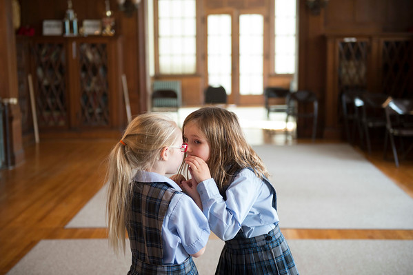 Joed Viera/Staff Photographer Lockport, NY- 1st-graders Samantha Fox and Courtney Parent tell each other secrets at Desales Catholic School.