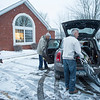 Joed Viera/Staff Photographer Lockport, NY- Santa supervises as members of the Mini Cooper Club pack their vehicles with presents destined to the Youth Mentoring Service of Niagara County.