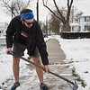 Joed Viera/Staff Photgrapher-Lockport, NY-Sporting shorts Josh Brennan casually shovels snow off of his Park Ave sidewalk.