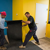 Joed Viera/Staff Photgrapher-Lockport, NY-Bobby Muscarella and Kevin Pratt Lay down rubber flooring inside a room at Ultimate Physique.