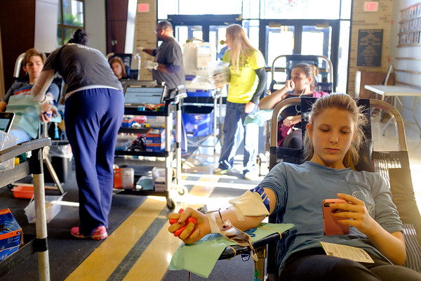 Joed Viera/Staff Photographer Lockport, NY-Lockport High School Junior Angel Cassenti, 16, passes time on her phone during the blood drive at the School. The school district is competing against city hall to see who collects the most blood.