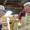 Joed Viera/Staff Photographer Buffalo, NY- Volunteers Jack Pittsley and Howard Wiseman help build the boat that will be used inside the flight of five at the Buffalo Maritime Center.