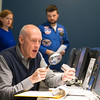 Joed Viera/Staff Photographer Lockport, NY-Tim Riemer analyzes a sample at Mission Control in the Challenger Learning Center during a space mission simulation.