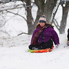 Joed Viera/Staff Photgrapher-Lockport, NY-A coat of fresh snow carries Grace, Anna and Jake Truax down a hill at Lockport Town and Country Clubon a trip visiting their grandparent from Atlanta.