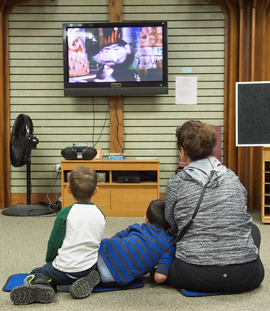 Joed Viera/ Staff Photographer- Lockport, NY-Francesco Rodriguez, 2, Anthony Rodriguez,  4 and Tamre Varallo watch Sesame Street's Count  while learning how to count in Hebrew during the Lockport Public Library's Hanukkah event.