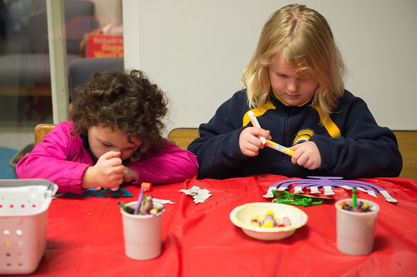 Joed Viera/ Staff Photographer- Lockport, NY-Quinn-Marie Carver, 4 and Samantha Harden, 9 make craft menorahs during the Lockport Public Library's Hanukkah event.