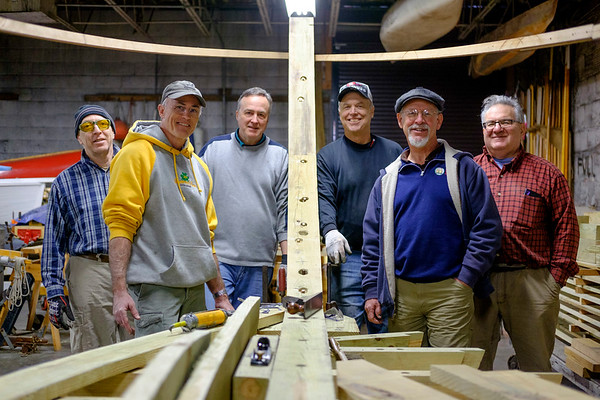 Joed Viera/Staff Photographer Buffalo, NY- Greg Garten, Brian Braisted, Chris Andrle, Jack Pittsley, Roger Allen and Howard Wiseman are volunteers building a boat that will be used inside the flight of five at the Buffalo Maritime Center.