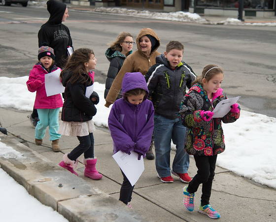Joed Viera/ Staff Photographer- Lockport, NY-Carollers from the YMCA stroll the streets of Lockport singing Christmas tunes.