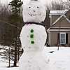 Joed Viera/ Staff Photographer- Pendleton, NY-A snowman sports a straw hat in front fo a Pendleton home on Mapleton Road..