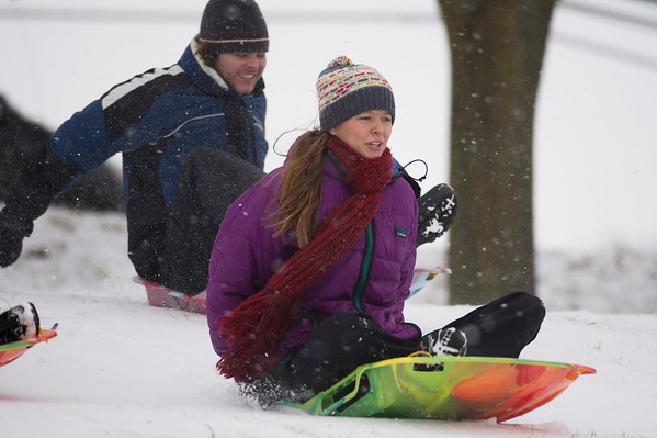 Joed Viera/Staff Photgrapher-Lockport, NY-A coat of fresh snow carries Anna and Jake Truax down a hill at Lockport Town and Country Club.