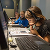 Joed Viera/Staff Photographer Lockport, NY-Cataract Elementary School student Cloey Davey, 10, communicates with the space craft on the navigation team looking for the comet Haley at the Challenger Center's central command.  Her 5th-grade class won the school's trip to Challenger Center.