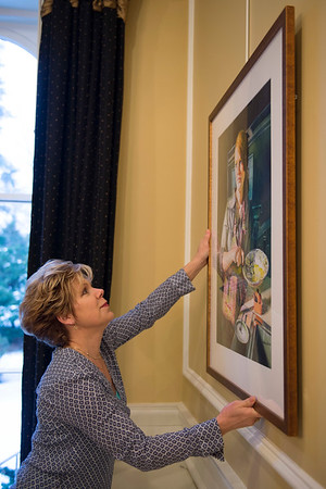 Joed Viera/Staff Photgrapher-Lockport, NY-Kathleen Giles hangs her painting at the Kenan House in preparation of her gallery opening with Jody Ziehm.