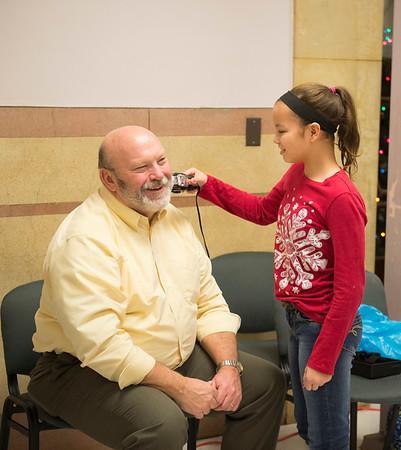 Joed Viera/Staff Photographer Lockport, NY-North Park Junior High School 7th-grader Cheyenne Harris, 12, takes a pair of clippers to the school's acting principal Wes Pickreign beard.