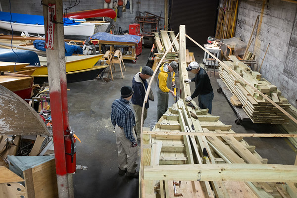 Joed Viera/Staff Photographer Buffalo, NY- Greg Garten, Roger Allen, Jack Pittsley and  Brian Braisted work on a durham boat at the Buffalo Maritime Center. When finished the boat will be placed into the Flight of Five.