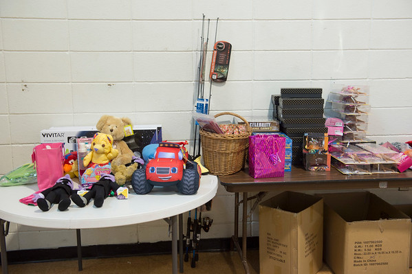 Joed Viera/Staff Photographer Lockport, NY-An overflow of donated toys fill tables inside the Salvation Army gym. 210 families lined up to collect gifts and dinners at the Salvation Army for the Christmas Assistance Program on Friday.