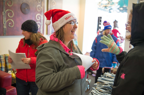 Joed Viera/Staff Photographer Lockport, NY-Selena Torres laughs with Juanita O'Harrow after singing Santa Clauss is coming to town as a part of carollers from People Inc's   Young Adult Life Transition Program at Bling.