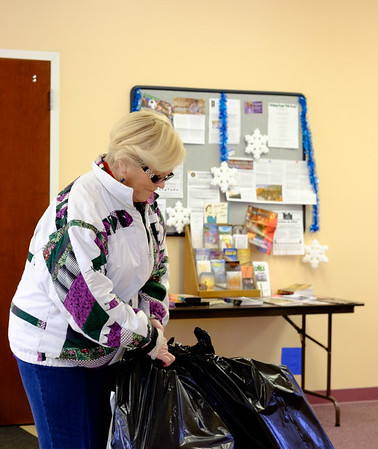 Joed Viera/Staff Photographer Newfane, NY-Janet George gets a package ready for a client of the Salvation Army's Christmas Assistance Program.