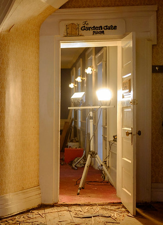 Joed Viera/Staff Photographer Wilson, NY-A worklight stands behind the doorway to the reconstruction of the former Garden Gate Room at the historical Wilson House.