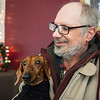 Joed Viera/Staff Photographer Lockport, NY-Rex Herl holds Weenie, his 10-year old, sweater-sporting Dachshund at Urban Park Towers. Herl brought the elderly hotdog down to the lobby to pick out a free sweater from the Paulette Coty run, Mario's Pet Food Pantry.