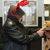 Joed Viera/Staff Photographer Lockport, NY-Paulette Coty pets Tobin Little's 1-year old long hair chihuahua Freckles during her visit to Urban Park Tower for Mario's Pet Food Pantry.