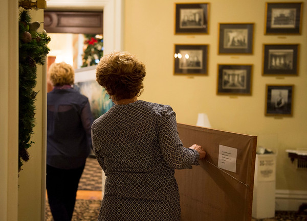 Joed Viera/Staff Photgrapher-Lockport, NY-Kathleen Giles and Jody Ziehm carry their paintings at the Kenan House in preparation of their gallery opening.