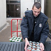 Joed Viera/Staff Photographer- Lockport, NY- Lockport Police officer Steve Tarnowski loads a truck with boxes packed with canned goods headed to the Salvation Army.