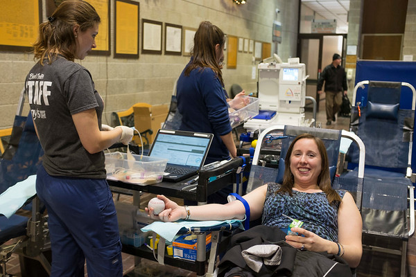Joed Viera/Staff Photographer Lockport, NY- Christine Savoia donates blood drive at City Hall. City Hall school district is competing against the school district to see who collects the most blood.