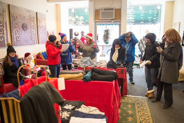 Joed Viera/Staff Photographer Lockport, NY-A group of carollers from People Inc's   Young Adult Life Transition Program stop by Bling to sing Santa Clauss is coming to town.