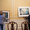 Joed Viera/Staff Photgrapher-Lockport, NY-Kathleen Giles and Jody Ziehm hang their paintings at the Kenan House in preparation of their gallery opening.