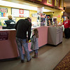 Joed Viera/ Staff Photographer- Lockport, NY-Joe Rex buys his daughter Lilly, 5, concessions at the Palace Theatre before the premiere of Moana.