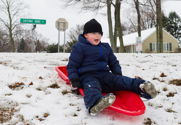 Joed Viera/Staff Photgrapher-Lockport, NY-A coat of fresh snow carries Maddox Scott, 6, down a hill at Lockport Town and Country Club.