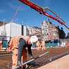 Level monitoring with surveying equipment for concrete pour