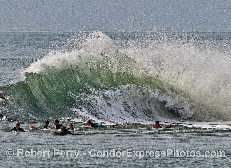 Image 4 of 4:  surfers, waves, Santa Barbara Harbor breakwater.