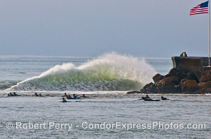 Image 1 of 4:  surfers, waves, Santa Barbara Harbor breakwater.