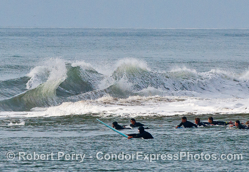 Image 2 of 4:  surfers, waves, Santa Barbara Harbor breakwater.