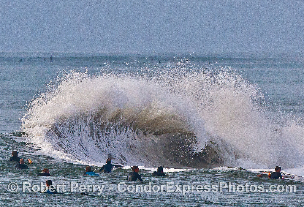 Image 3 of 4:  surfers, waves, Santa Barbara Harbor breakwater.