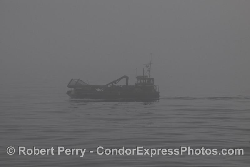 "Kelp cutter ""Ocean Harvest"" in the fog."
