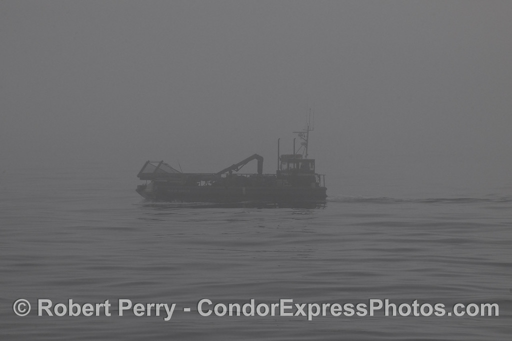 "Kelp cutter ""Ocean Harvest"" in the fog."