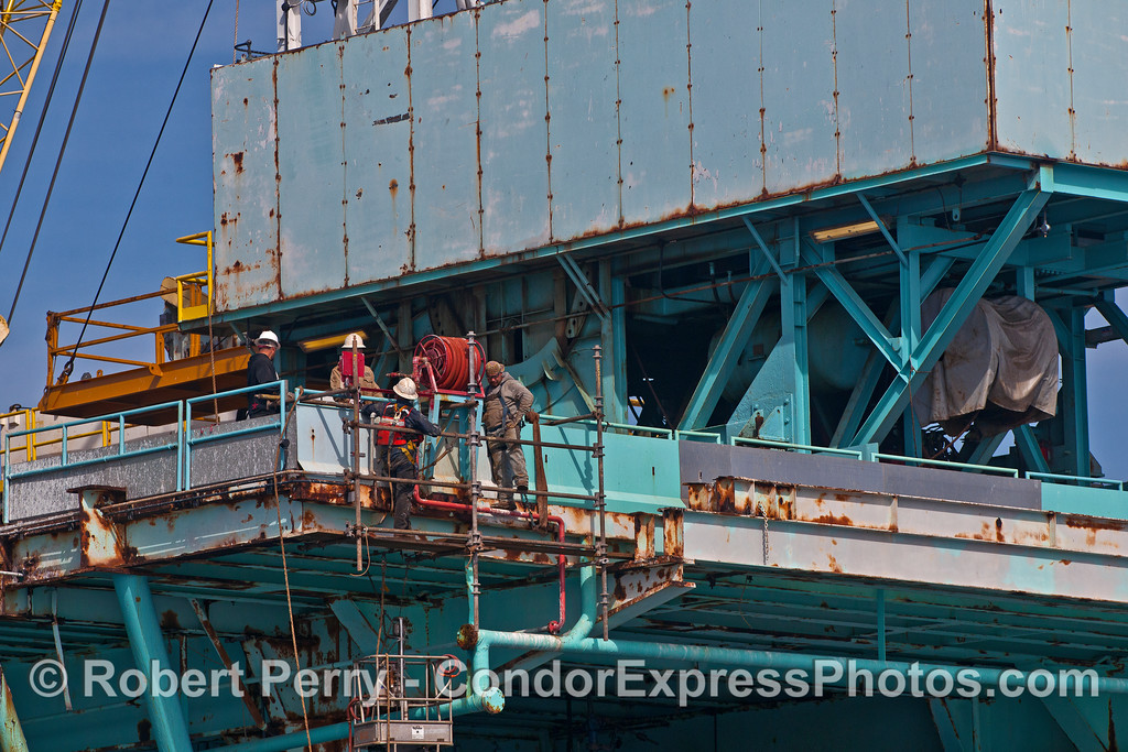Men at work.  Offshore oil platform Charlie.