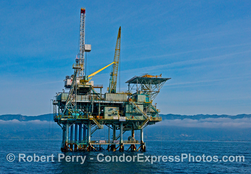 Offshore oil platform Henry - Santa Barbara Channel.   Note the yellow helicopter resting on the upper deck.