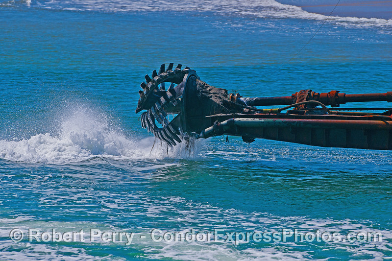 "Water jets and a grinding auger mark the ""business end"" of the harbor dredge barge ""La Encina."""