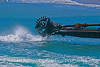 """Water jets and a grinding auger mark the """"business end"""" of the harbor dredge barge """"La Encina."""""""