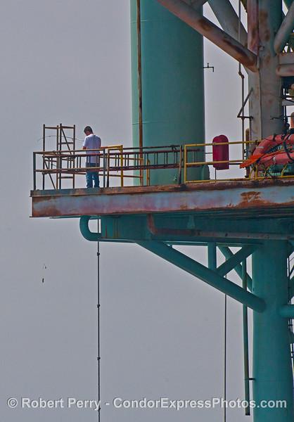 Worker on Platform Houchin takes a break to go fishing.