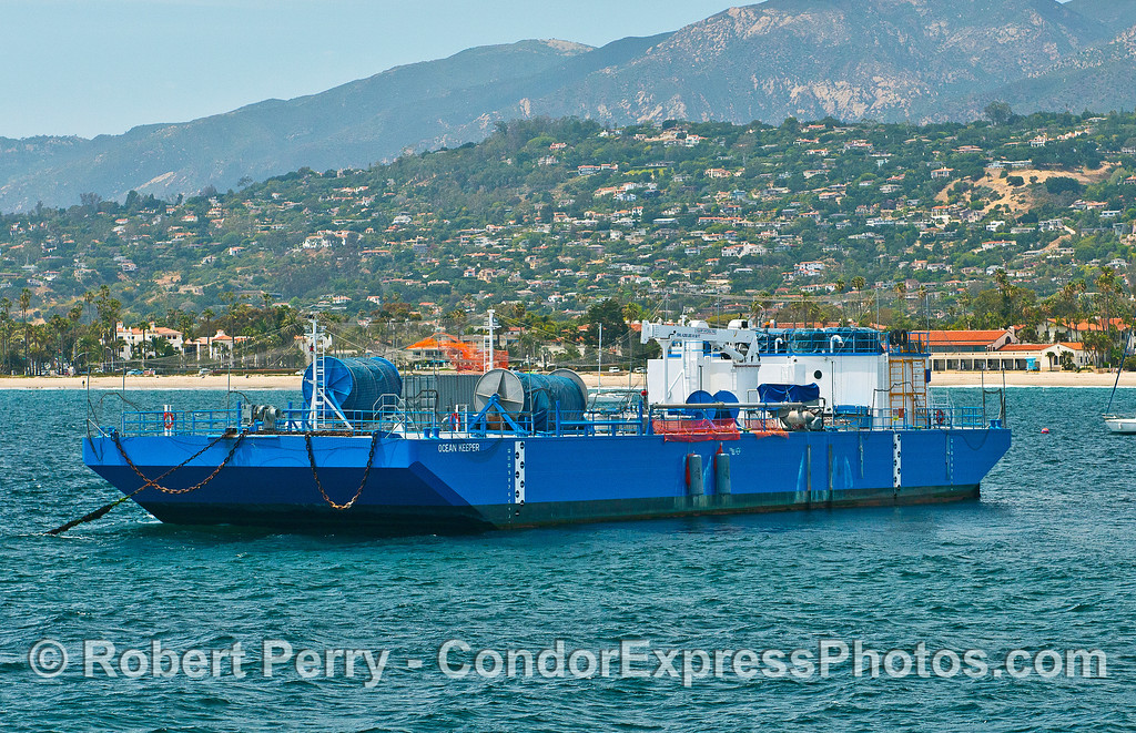 """Ocean Keeper""  An oil spill containment barge and largest object moored in the East Beach Anchorage, Santa Barbara."