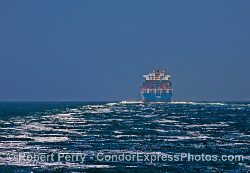 "Image 1 of 2:  A big wake from container ship ""Archmidis"" running up the Channel at 20 knots."