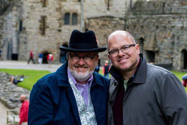 Photo of David and Patrick standing in the courtyard of Caenarfon Castle